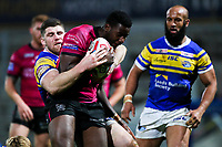 Picture by Alex Whitehead/SWpix.com - 08/03/2018 - Rugby League - Betfred Super League - Leeds Rhinos v Hull FC - Emerald Headingley Stadium, Leeds, England -Hull FC's Masi Matongo is tackled by Leeds' Mitch Garbutt.