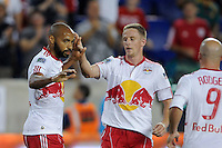 Thierry Henry (14) of the New York Red Bulls celebrates with Jan Gunnar Solli (8) after the team's first goal. The New York Red Bulls defeated the New England Revolution 2-1 during a Major League Soccer (MLS) match at Red Bull Arena in Harrison, NJ, on June 10, 2011.