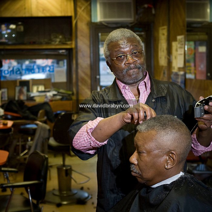 Ralph Nixon, a barber, seen here in his salon on Lenox Avenue in Harlem, New York, NY, United States, poses for the photograph, 30 October 2008.