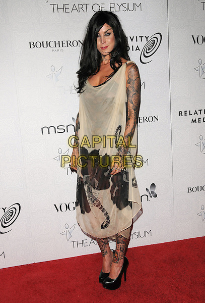 "KAT VON D aka Katherine Von Drachenberg.Art of Elysium 3rd Annual Black Tie charity gala '""Heaven"" held at 990 Wilshire Blvd in Beverly Hills, California, USA, .January 16th 2010 .full length tattoos beige print black shoes dress platform sleeveless .CAP/RKE/DVS .©DVS/RockinExposures/Capital Pictures"