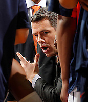 Virginia head coach Tony Bennett talks to his players in the huddle during the game against Maryland Sunday in Charlottesville, VA.  Photo/Andrew Shurtleff
