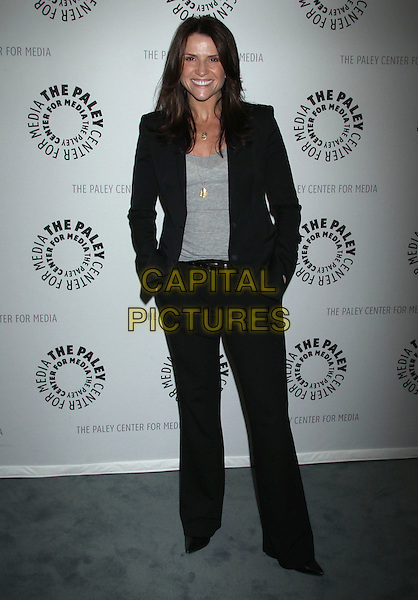 """Gina Matthews.""""Missing"""" Premiere Screening presented by The Paley Center for Media held at The Paley Center For Media, Beverly Hills, California, USA..April 10th, 2012.full length black suit grey gray top.CAP/ADM/RE.©Russ Elliot/AdMedia/Capital Pictures."""