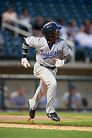 Pensacola Blue Wahoos second baseman Shed Long (4) runs to first base during a game against the Birmingham Barons on May 8, 2018 at Regions Field in Birmingham, Alabama.  Birmingham defeated Pensacola 5-2.  (Mike Janes/Four Seam Images)