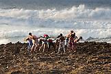 HAWAII, Oahu, North Shore, yoga on the rocks near the ocean at Turtle Bay Resort