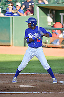 Deivy Castillo (12) of the Ogden Raptors at bat against the Idaho Falls Chukars in Pioneer League action at Lindquist Field on June 22, 2015 in Ogden, Utah.The Chukars defeated the Raptors 4-3 in 11 innings.  (Stephen Smith/Four Seam Images)