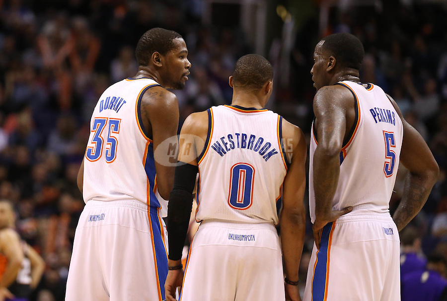 Feb. 10, 2013; Phoenix, AZ, USA: Oklahoma City Thunder small forward Kevin Durant (35), point guard Russell Westbrook (0) and center Kendrick Perkins (5) against the Phoenix Suns at the US Airways Center. Mandatory Credit: Mark J. Rebilas-