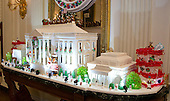 """The 2016 White House Christmas decorations are previewed for the press at the White House in Washington, DC on Tuesday, November 29, 2016.  Pictured is the White House Gingerbread House that is made with 150 pounds of gingerbread on the inside, 100 pounds of bread dough on the outside frame, 20 pounds of gum paste, 20 pounds of icing, and 20 pounds of sculpted sugar pieces. The Obama dogs Bo and Sunny are featured. The first lady's office released the following statement to describe those decorations, """"This year's holiday theme, 'The Gift of the Holidays,' reflects on not only the joy of giving and receiving, but also the true gifts of life, such as service, friends and family, education, and good health, as we celebrate the holiday season.""""<br /> Credit: Ron Sachs / CNP"""