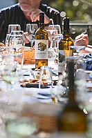 glasses and bottles on a lunch table quinta de la rosa douro portugal