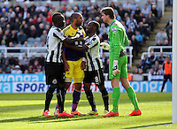 Pictured: Ashley Williams of Swansea (2nd L_ is held back by Cheik Tiote (L) and Vernon Anita (3rd L) of Newcastle as the former tries to square up against goalkeeper Tim Krul. Saturday 19 April 2014<br />