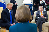 US President Donald J. Trump (L) meets with US House Speaker-designate Nancy Pelosi (C) and US Senate Minority Leader Chuck Schumer (R), in the Oval Office of the White House in Washington, DC, USA, 11 December 2018. Trump, Pelosi and Schumer had a disagreement on border policy and shutting down the government.<br /> Credit: Michael Reynolds / Pool via CNP