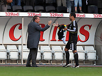 Pictured: Brendan Rodgers manager of Swansea City shakes hands with Michel Vorm. Saturday 17 September 2011<br /> Re: Premiership football Swansea City FC v West Bromwich Albion at the Liberty Stadium, south Wales.