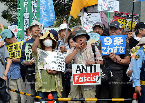 "July 1, 2014, Tokyo,Japan - Carrying placards and banners, thousands of protesters gather outside Prime Minister Shinzo Abe's office in Tokyo to show their opposition to a historic move to lift a self-imposed ban on exercising the right to collective self-defense on Tuesday, July 1, 2014. Abe's Cabinet is set to approve a reinterpretation of Article 9 of the nation's U.S.-drafted post-World War II constitution, which renounces war. Under the new rules, Japan's military would be allowed to exercise the right to ""collective self-defense."" The change is intended to allow Japan to defend friendly nations that come under attack.  (Photo by Natsuki Sakai/AFLO)"