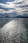 Ship's wake of Hurtigruten ferry sea between Harstad and Stokmarknes, Norway