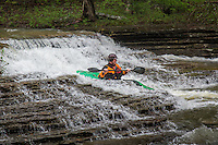 Kayaker going over Six Finger Falls in the fall on Richland Creek in the Ozark National Forest in Arkansas.
