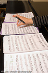 Middle School grade 8 music education grade 8 closeup of teacher's hand and music vertical