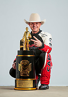 Feb 20, 2020; Chandler, Arizona, USA; NHRA top fuel driver Steve Torrence poses for a portrait with his world championship trophy during the Arizona Nationals at Wild Horse Pass Motorsports Park. Mandatory Credit: Mark J. Rebilas-USA TODAY Sports