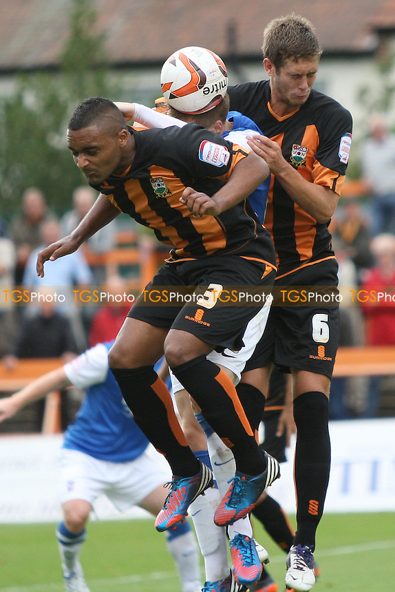 Jordan Brown of Barnet and Jack Saville of Barnet make a sandwich of Jason Walker of York City - Barnet vs York City - NPower League Two Football at Underhill Stadium, High Barnet, London - 25/08/12 - MANDATORY CREDIT: George Phillipou/TGSPHOTO - Self billing applies where appropriate - 0845 094 6026 - contact@tgsphoto.co.uk - NO UNPAID USE.