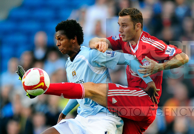 Fabio Aurelio of Liverpool tackles Jo of Manchester City