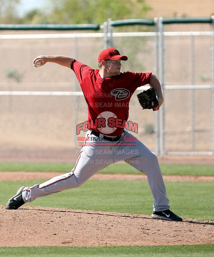 Kevin Munson #20 of the Arizona Diamondbacks pitches in a minor league spring training game against the Colorado Rockies at the Diamondbacks minor league complex on April 1, 2011  in Scottsdale, Arizona. .Photo by:  Bill Mitchell/Four Seam Images.