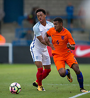 Chris Willock (Benfica) of England U20 battles Juninho Bacuna (FC Groningen) of Netherlands during the International friendly match between England U20 and Netherlands U20 at New Bucks Head, Telford, England on 31 August 2017. Photo by Andy Rowland.
