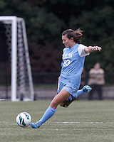 University of North Carolina midfielder Brooke Elby (93) passes the ball.   University of North Carolina (blue) defeated Boston College (white), 1-0, at Newton Campus Field, on October 13, 2013.