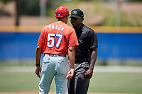 GCL Phillies West manager Nelson Prada (57) argues with umpire Tre Jester during a game against the GCL Blue Jays on August 7, 2018 at Bobby Mattick Complex in Dunedin, Florida.  GCL Blue Jays defeated GCL Phillies West 11-5.  (Mike Janes/Four Seam Images)