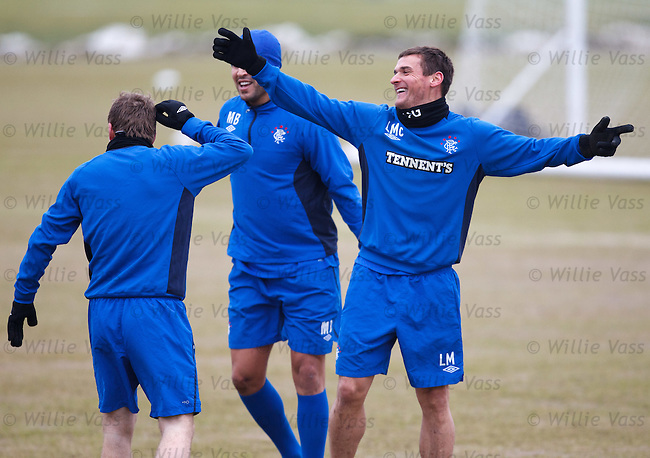 """Lee McCulloch, Steven Davis and Madjid Bougherra celebrate after """"tagging"""" their team-mates at training"""
