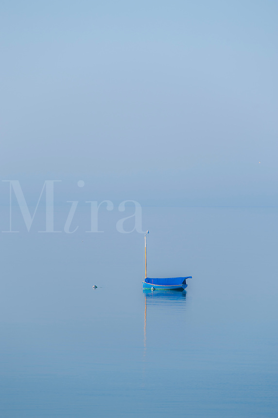 Small sailboat on misty water, Truro, Cape Cod, MA