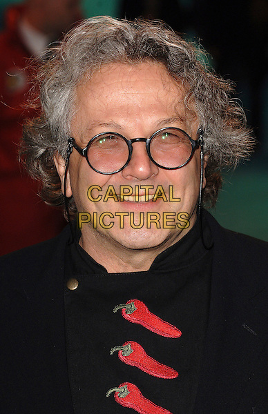 "GEORGE MILLER.Attending the UK film premiere of ""Happy Feet"", .Empire Leicester Square, London, England,.26th November 2006..portrait headshot glasses red chillies.CAP/ BEL.©Tom Belcher/Capital Pictures."