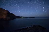 Stars in the blue night sky and the lights of Rapid Bay are almost equally bright seen from Second Valley at night.