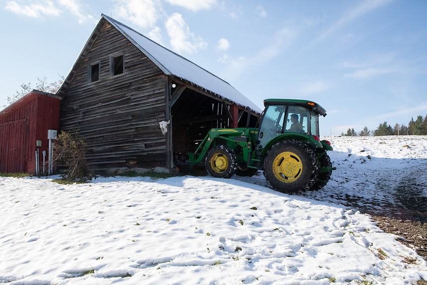 NORTHFIELD, VERMONT - Nathaniel Miller on his farm, Falling Damps Farm.<br /> changing out the front end of the tractor with a forklift.