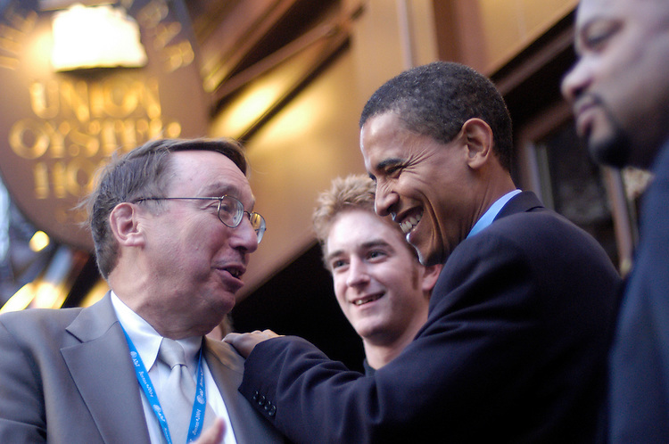 Reporter Paul Green, WGN Radio Chicago, shares a laugh with Senate candidate Barack Obama, D-Il., the night before the Democratic National Convention 2004 in front of the Illinois delegation party at the Ye Olde Oyster House in Boston, Ma. .