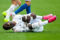Modu Barrow of Swansea clutches his leg during the Barclays Premier League match between Swansea City and Everton played at the Liberty Stadium, Swansea  on September 19th 2015