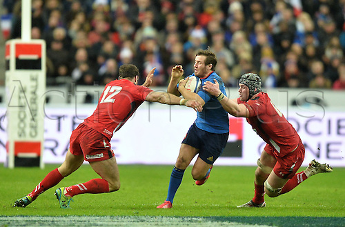 28.02.2015. Stade de France, Paris, France. 6 Nations International Rugby. France versus Wales.  Camille Lopez (fra) tackled by Roberts (Wales) and Lydiate