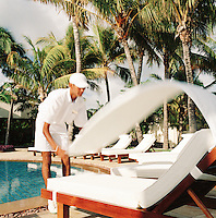 Pool attendant at The One and Only Le Touessrok Hotel, Mauritius