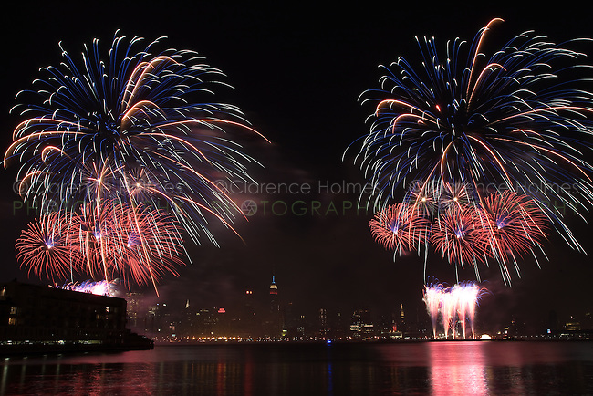 WEEHAWKEN, NJ - JULY 4: The annual Macy's Fourth of July fireworks extravaganza lights the sky over the Hudson river on Saturday, July 4, 2009 as seen from Weehawken, New Jersey on the west side of the river.  The fireworks were moved from the East River to the Hudson River for 2009 to celebrate the 400th anniversary of Henry Hudson's exploration of the Hudson river.