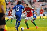 Tuesday, 7 May 2013<br /> <br /> Pictured: Angel Rangel of Swansea City,Roger Espinoza of Wigan Athletic<br /> <br /> Re: Barclays Premier League Wigan Athletic v Swansea City FC  at the DW Stadium, Wigan
