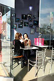 USA, California, San Diego, two women chat over gelato at Frizzante Gelateria