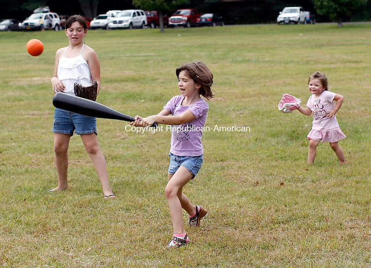 Thomaston, CT- 05, September 2011-090511CM06  Andrea Nettis, 8, of Wallingford hits the ball while playing with her sister, Alissa,  and cousin Riley Shortt , 2, of Oakville Monday afternoon at Black Rock State Park in Thomaston.  The trio were with their families celebrating Labor Day and Andrea's 8th birthday, which included picnicking, playing ball and fishing.  Christopher Massa Republican-American