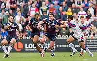 Picture by Allan McKenzie/SWpix.com - 08/04/2018 - Rugby League - Betfred Super League - Wakefield Trinity v Leeds Rhinos - The Mobile Rocket Stadium, Wakefield, England - Leeds's Brett Ferres fends off Wakefield's Bill Tupou.