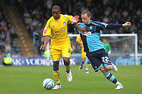 Kevin Lisbie of Colchester United tries to shake off a challenge from Wycombe's Scott Davies during Wycombe Wanderers vs Colchester United, Coca Cola League Division One Football at Adams Park on 17th October 2009