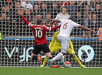 Pictured L-R: Wayne Rooney of Manchester United loses the ball to Swansea defender Ashley Williams Sunday 30 August 2015<br /> Re: Premier League, Swansea v Manchester United at the Liberty Stadium, Swansea, UK