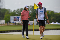 Tommy Fleetwood (ENG) and his caddie share a laugh as they depart 13 during day 2 of the WGC Dell Match Play, at the Austin Country Club, Austin, Texas, USA. 3/28/2019.<br /> Picture: Golffile | Ken Murray<br /> <br /> <br /> All photo usage must carry mandatory copyright credit (© Golffile | Ken Murray)