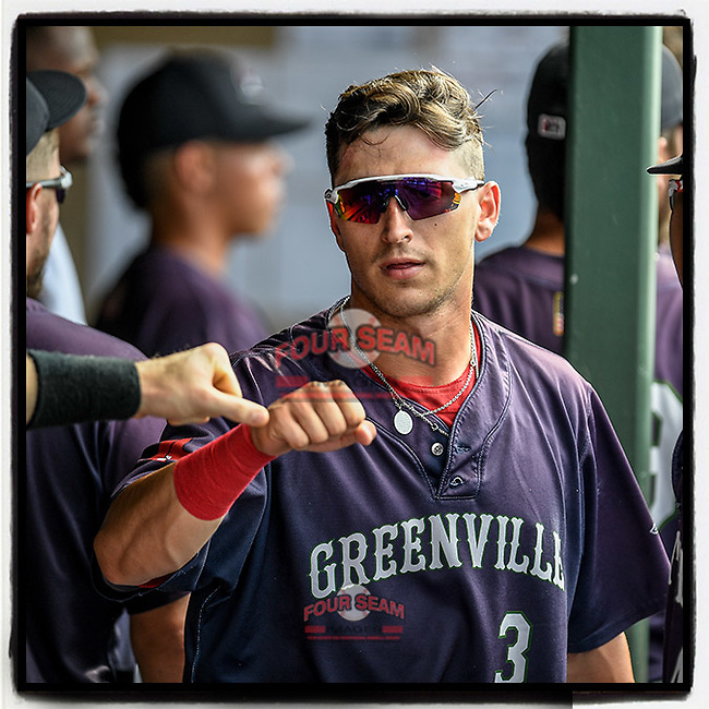 Designated hitter Jordan Wren (3) of the Greenville Drive is greeted in the dugout after scoring a run in a game against the Delmarva Shorebirds on Friday, August 2, 2019, in the continuation of rain-shortened game begun August 1, at Fluor Field at the West End in Greenville, South Carolina. Delmarva won, 8-5. (Tom Priddy/Four Seam Images) #MiLB