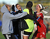 Erica Bulzomi, Syosset goalie, second from right, gets mobbed by teammates after the Lady Braves' 2-1 win over host East Meadow High School in a Nassau County Class AA varsity girls soccer quarterfinal on Tuesday, Oct. 25, 2016.