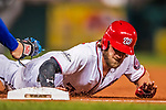 6 October 2017: Washington Nationals outfielder Bryce Harper dives safely back to first during the first game of the NLDS against the Chicago Cubs at Nationals Park in Washington, DC. The Cubs shut out the Nationals 3-0 to take a 1-0 lead in their best of five Postseason series. Mandatory Credit: Ed Wolfstein Photo *** RAW (NEF) Image File Available ***