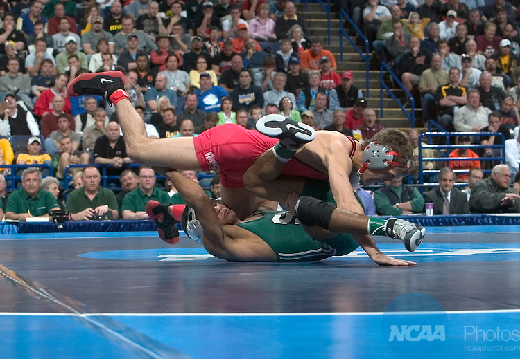 21 MARCH 2009;   Franklin Gomez (in green) of Michigan State University wrestles with Reece Humphrey (in red) of Ohio State University during their 133 pound championship match at the 2009 NCAA Division 1 Men's Wrestling Championships at Scottrade Center in St. Louis, MO. Gomez defeated Humphrey 5-4 to win the 133 pound national title.   Mark Buckner/NCAA Photos