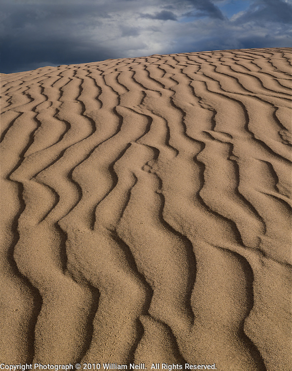 Dune Pattern and Storm Clouds, Death Valley National Park, California