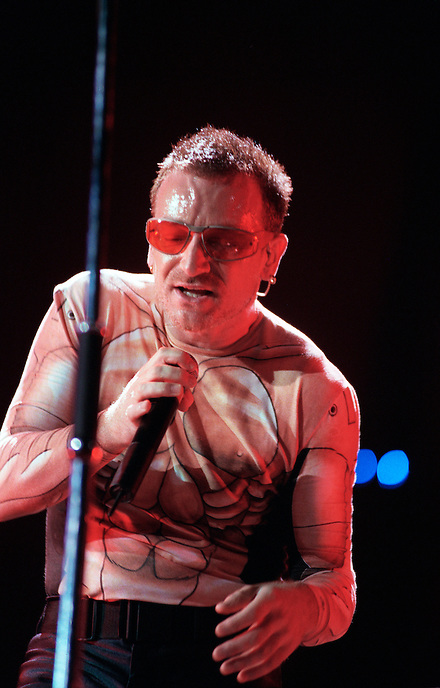 Bono, of the Irish rock band U2 performs during a concert at the Los Angeles Coliseum in 1997. The PopMart Tour was in support of the group's 1997 album, Pop.