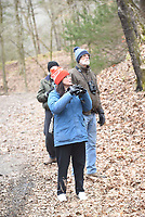 NWA Democrat-Gazette/FLIP PUTTHOFF <br /> Liz Adam (center) looks for birds Feb. 16 2019 during the field trip.